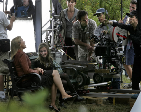 Annette Bening (left) laughed with India Ennenga, 12, on a park bench at Bullough Park in Newton between filming scenes for the movie 'The Women.' Ennenga plays the daughter of actor Meg Ryan's character, and the park is standing in for a location in Connecticut.