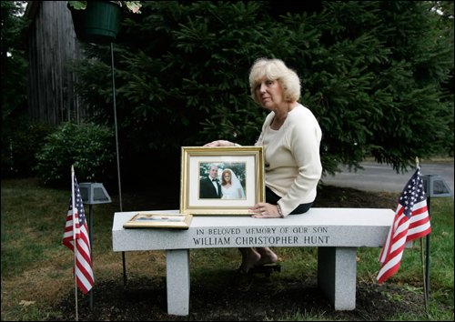 On Monday, Diane Hunt held a photo of her son William Christopher Hunt, who was killed in the terrorist attacks of Sept. 11, 2001. On Tuesday, she led a sixth-anniversary commemoration at the State House.