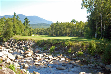 The Sugarloaf Golf Club plays over and around the Carrabassett River, including the tee shot on the par-5 12th hole.