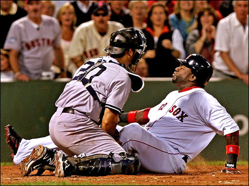 Trying to score from second base, David Ortiz (right) was caught at the plate and tagged out by Jorge Posada (left).