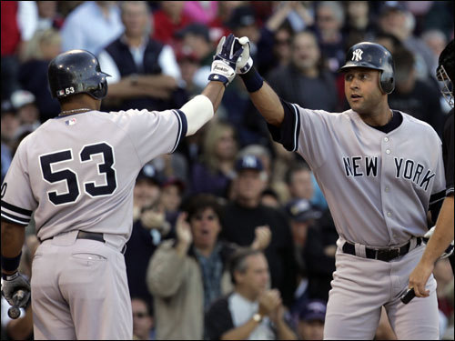 Yankees right fielder Bobby Abreu (left) congratulated Derek Jeter on Jeter's solo home run in the first.