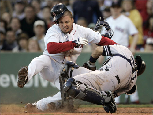 Posada held on to the ball for the out at home plate in the bottom of the sixth inning.