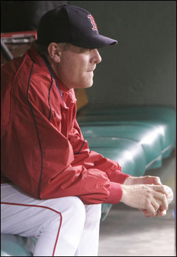Red Sox starter Curt Schilling sat in the dugout before the game.