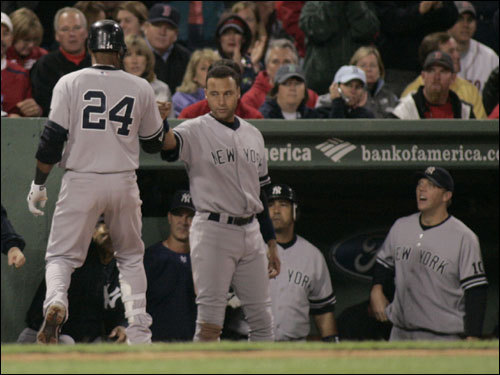 Robinson Cano (24) celebrated his solo home run during the fifth inning with teammate Derek Jeter.