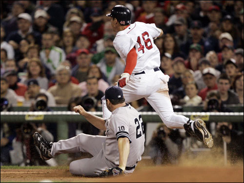 Red Sox rookie Jacoby Ellsbury (46) was out at first on a ground out as Roger Clemens (22) covered first base with a slide in the fifth inning.