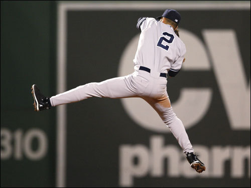 Yankees shortstop Derek Jeter elevated to rob Eric Hinske (not pictured) of a hit in the fourth inning.