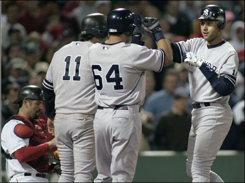 Yankees Derek Jeter (2), Bronson Sardinha (54) and Doug Mientkiewicz celebrated his three-run home run during the eighth inning.