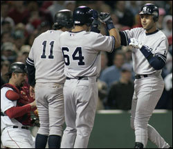 Derek Jeter celebrates with teammates after his three-run homer in the eighth inning off Curt Schilling provided the Yankees the margin they needed to beat the Red Sox.