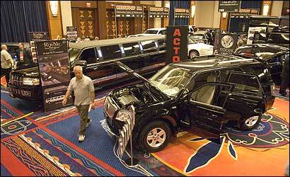 Stretch limos dominated at a limousine convention in Connecticut this week, but the shorter Mercury Mariner hybrid was the bid draw.