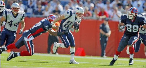 Wes Welker fought for extra yardage after one of his team-leading six receptions.