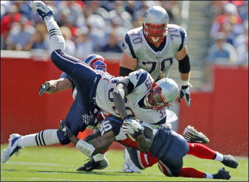 Laurence Maroney was upended by Bills DB Kiwaukee Thomas, but not before picking up some good yardage.