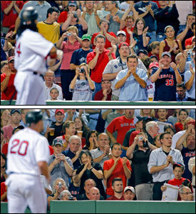 Fans let Manny ramirez (top) and Kevin Youkilis know they were back where they belonged as the two returned.