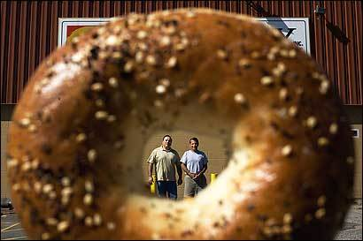 Presidents and co-owners of Bagel Boy Chuck Bouchrouche, left, and John Boghos stand in front of their facility in Lawrence.