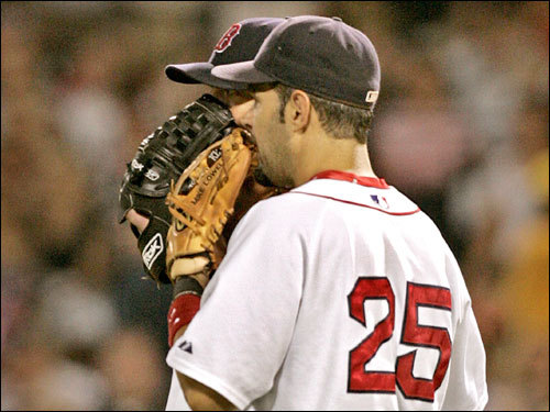 Mike Lowell (right) and Josh Beckett (left) talked on the mound in the fifth inning. Beckett left the game after giving up five earned runs.