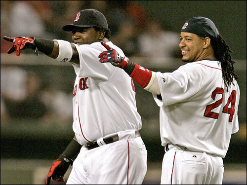 Red Sox sluggers David Ortiz (left) and Manny Ramirez (right) worked out before the game.