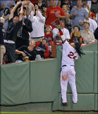 Red Sox left fielder Manny Ramirez jumped for a foul ball that found the seats in the second inning.