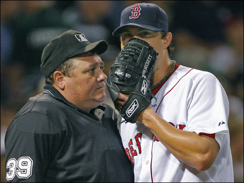 Josh Beckett had a word with home plate umpire Larry Poncino after the last out of the fifth inning.