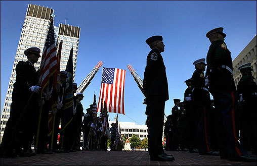 At the national POW-MIA Recognition Day at Boston City Hall Plaza, color guards from all armed services stood at attention during the reading of the Massachusetts Missing In Action roll call. The Boston Fire Department displayed an American flag as the backdrop for the Sept. 21 ceremony.