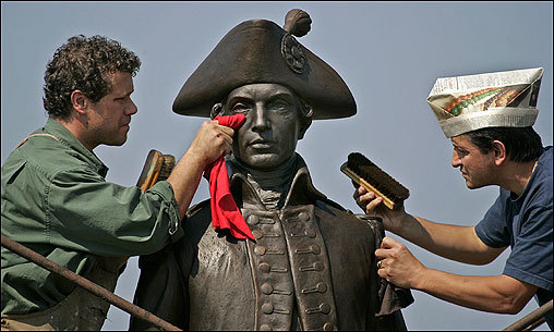 Sculptors Jeff Buccacio (left) and Ndricim Bejao brushed and removed wax from a statue of Loammi Baldwin, who was born in Woburn in 1745 and was the engineer of the Middlesex Canal, for a dedication ceremony on Oct. 20.