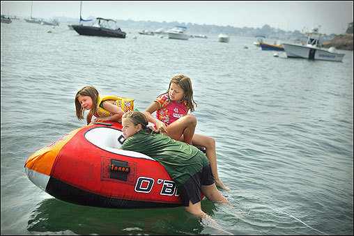 From left: Allyson Hartmann, 6, Elizabeth Tibbetts,10, and Meghan Hartmann, 9, enjoyed floating in Swampscott Harbor on Sept. 22. Though fall began this week, temperatures remained in the high 70s and 80s.