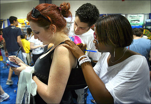 Lesley University students (from left) Arley Betteridge, Jeff Tardiff, and Allison Ousley signed contest forms from Planned Parenthood at College Fest 2007 in Boston's Hynes Convention Center on Sept. 22. Dozens of local and national companies attended the event to try to attract college graduates.