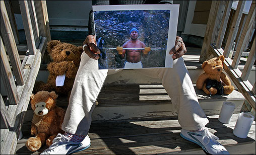 The mother of shooting victim Urel Duncan held a photo of her son and sat in the spot where he was killed at 60 Codman Park in Roxbury. The steps hosted a makeshift memorial where friends and relatives left candles, baseball hats, and Teddy bears.