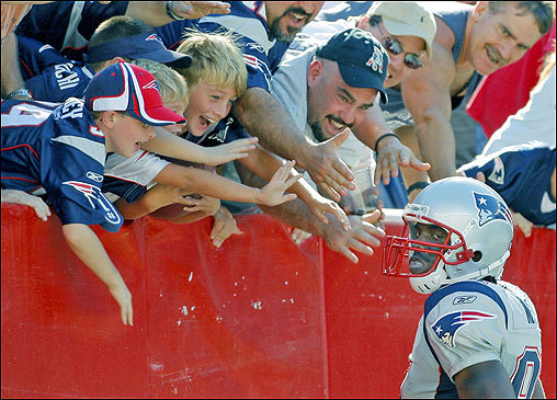 Patriots wide receiver Randy Moss (81) gave the football to some young fans in the end zone after he hauled in a 45-yard touchdown pass from Tom Brady, his second of the game, which sealed New England's 38-7 victory over the Buffalo Bills at Gillette Stadium on Sept. 23.
