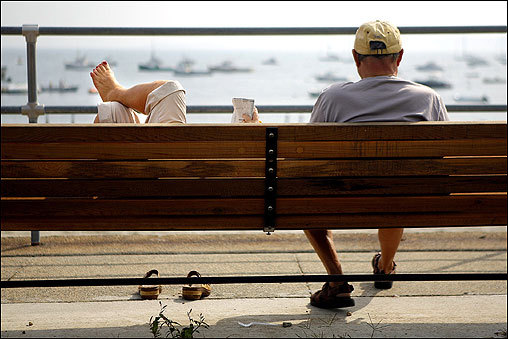 A couple relaxed near the Swampscott Harbor on Sept. 22.