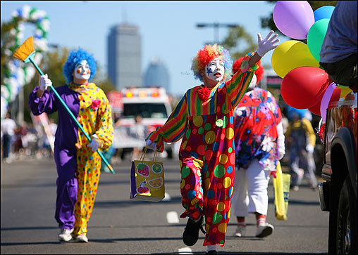 Erik Fitzgerald (center), 11, of Brighton, marched in the Allston-Brighton parade as a clown with a group from the Abundant Grace Church of Boston. The Allston-Brighton parade lit up the neighborhood streets on Sept. 23.