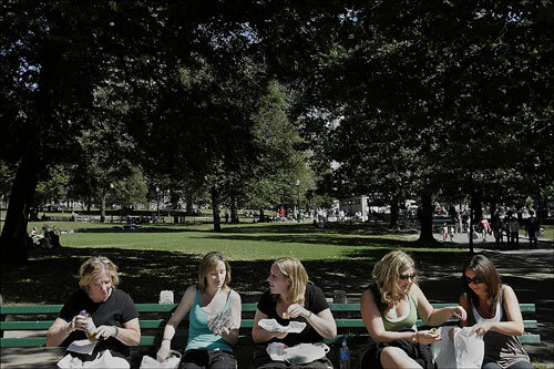 From left: Nancy Moloney, Nicola Clasby, Sam Gurr, Laurie Shilale, and Denise Papa took a lunch break on the Common. The group was attending a seminar at the Hyatt hotel at Downtown Crossing.