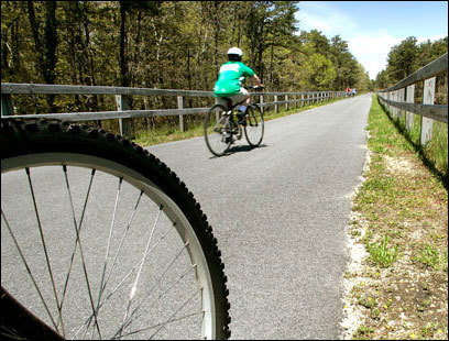 Bikers ride the newly refurbished Cape Cod Rail Trail in Harwich.