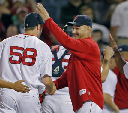 Red Sox manager Terry Francona (right) has a big smile and a pat on the head for Papelbon.