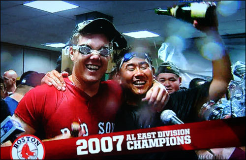 The Red Sox clinched their first division title in 12 years Friday night by beating the Twins 5-2 at Fenway and then watching the Orioles rally to beat the Yankees in extra innings. (NESN Screen shot)
