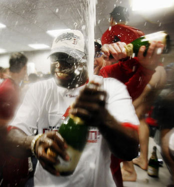 David Ortiz sprayed champagne in the locker room.