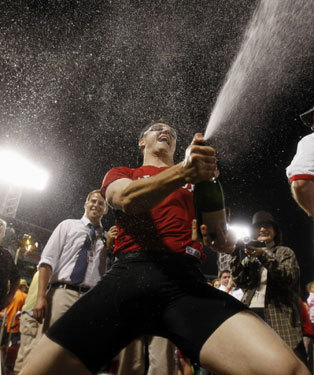 Jonathan Papelbon sprayed the fans that had stuck around with champagne.