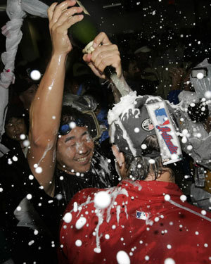 Daisuke Matsuzaka, who picked up the victory with eight strong innings Friday, dumped champagne over Josh Beckett's head.