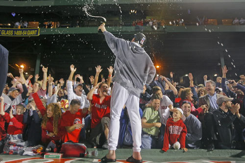 Curt Schilling stood on the dugout and sprayed jubilant fans with champagne.