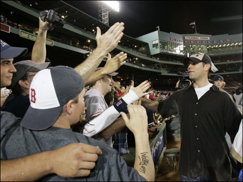 Theo Epstein celebrated with the fans.