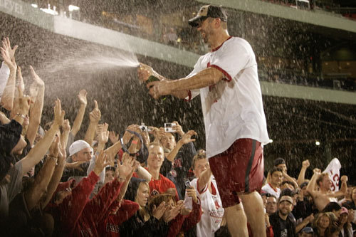 Jason Varitek took a turn hosing down the fans with a bottle of bubbly as well.