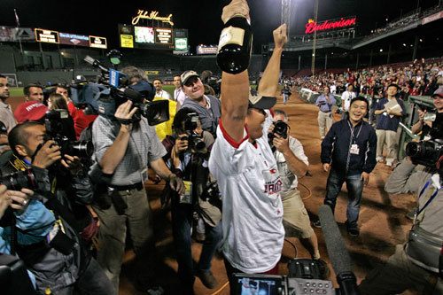 Matsuzaka raised his arms to the fans in an on-field celebration.