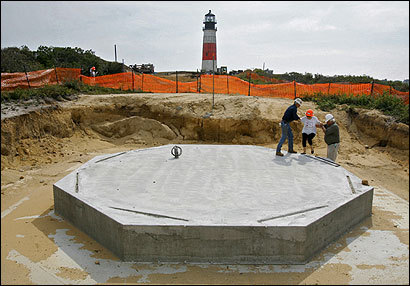 The Sankaty Head Lighthouse will begin its move to a new site (foreground) tomorrow because of the threat of an eroding bluff.