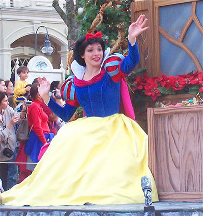 Snow White waves to the crowd along the parade route...