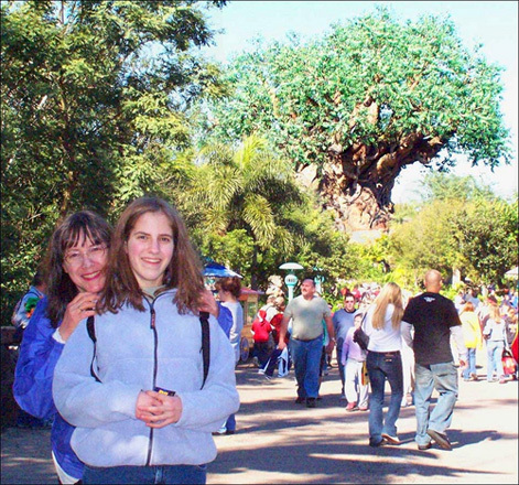 Kelly and my mom pose in front of the Tree of Life at Disney's Animal Kingdom theme park. If you get up close, you can see animals carved into the trunk of the tree.