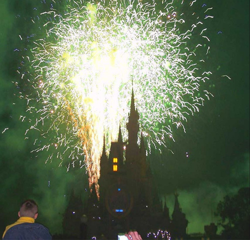At night, fireworks over Cinderella's Castle light up the Magic Kingdom skies.
