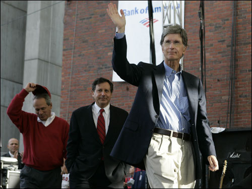 Red Sox owner John Henry (right) waved as he arrived with chairman Tom Werner and president Larry Lucchino.
