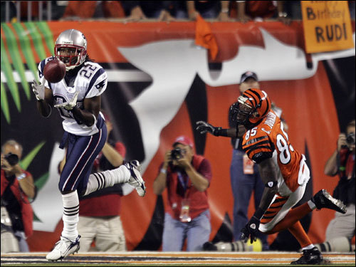 With the Bengals threatening late in the first half, Patriots CB Asante Samuel (left) intercepted a pass in front of Bengals wide receiver Chad Johnson (right).