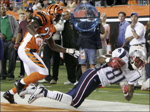 Randy Moss (right) landed in bounds for a touchdown in the second quarter.