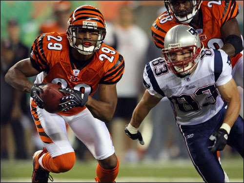 Bengals corner Leon Hall (right) intercepted a pass intended for Wes Welker in the first half.