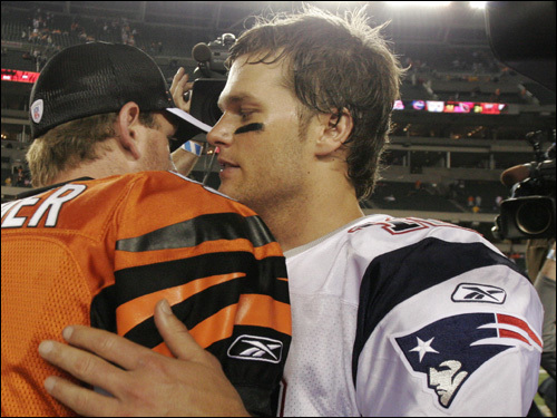 Tom Brady (right) chatted with Bengals quarterback Carson Palmer following the game.
