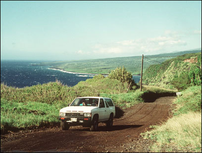 Tourists enjoy the scenic view from the Hana Highway.